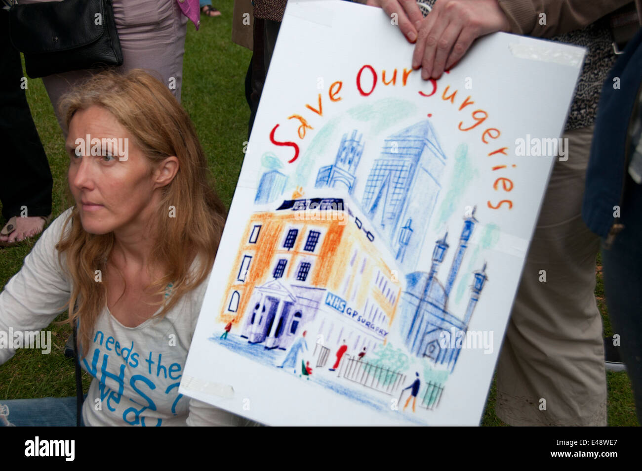 East End, London July 5th 2014. Rally and march against proposed cuts to National Health Service doctors' surgeries - Stock Image