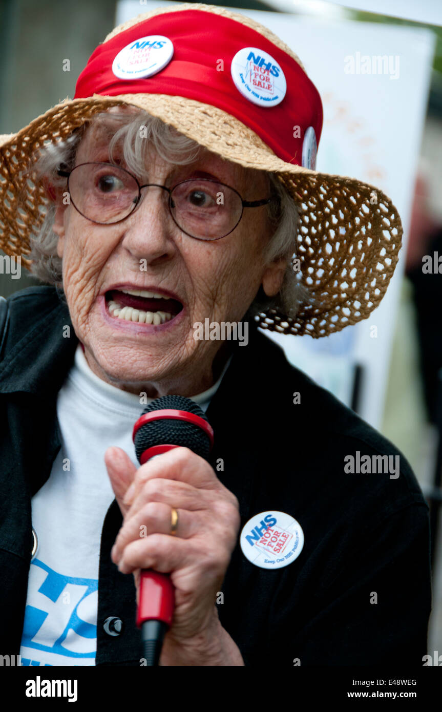 Rally and march against proposed cuts to National Health Service doctors' surgeries. 83 year old Shirley Murgraff, - Stock Image