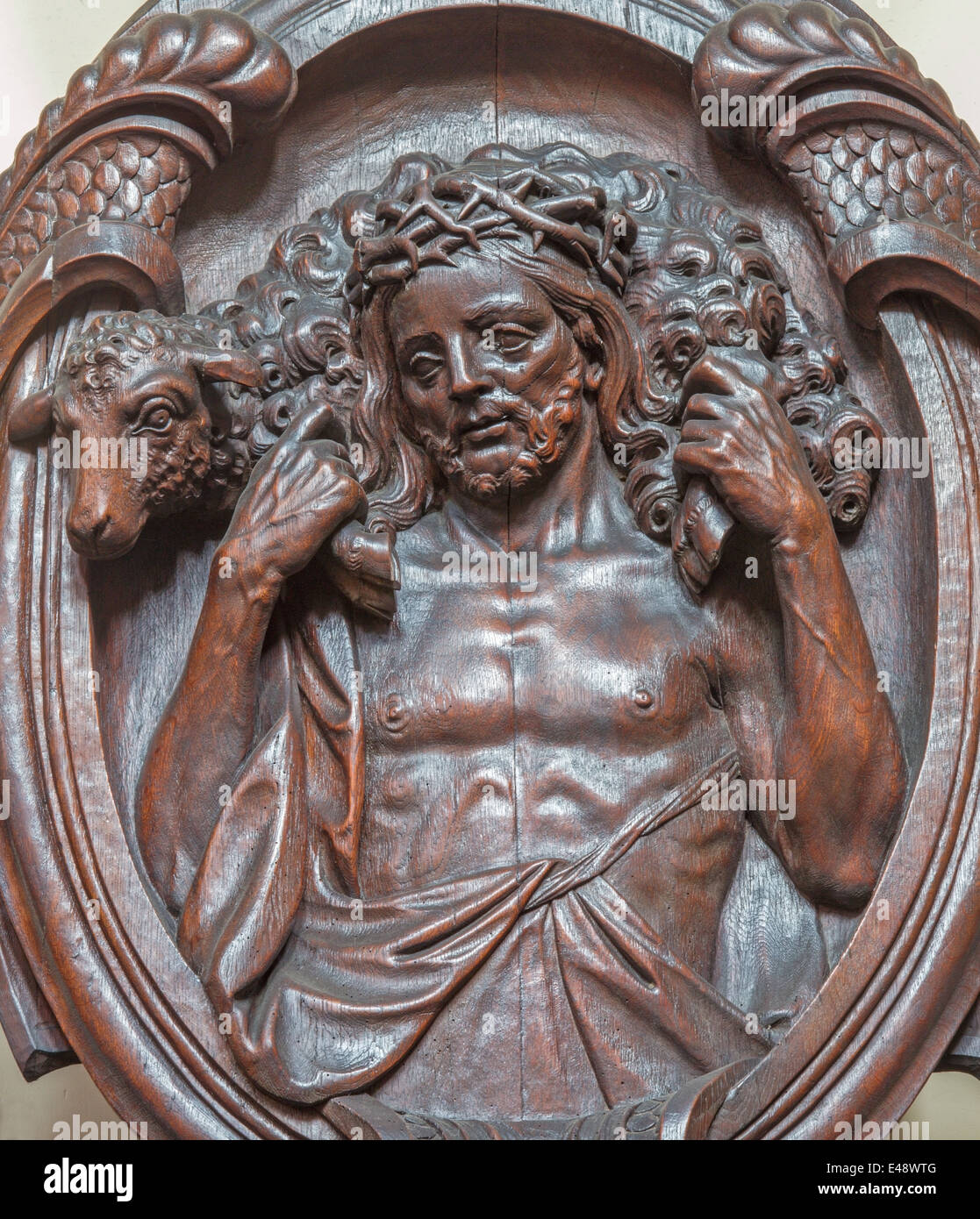 Bruges - the carved relief of Good shepherd on the confession box in Karmelietenkerk (Carmelites church) - Stock Image