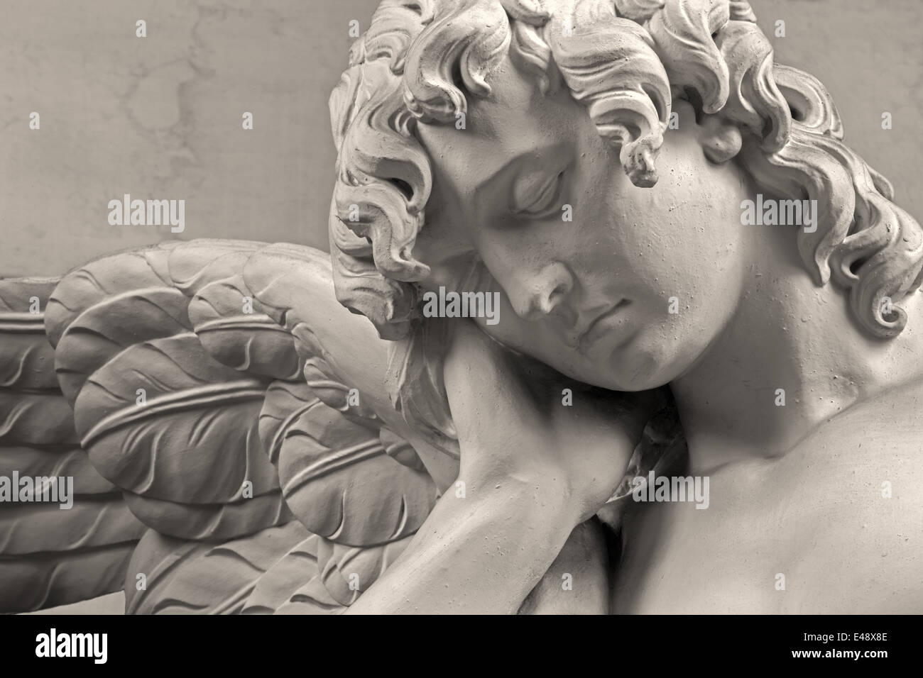 MECHELEN, BELGIUM - JUNE 14, 2014: The sorrow of angel. Detail of stone statue in church Our Lady across de Dyle. - Stock Image