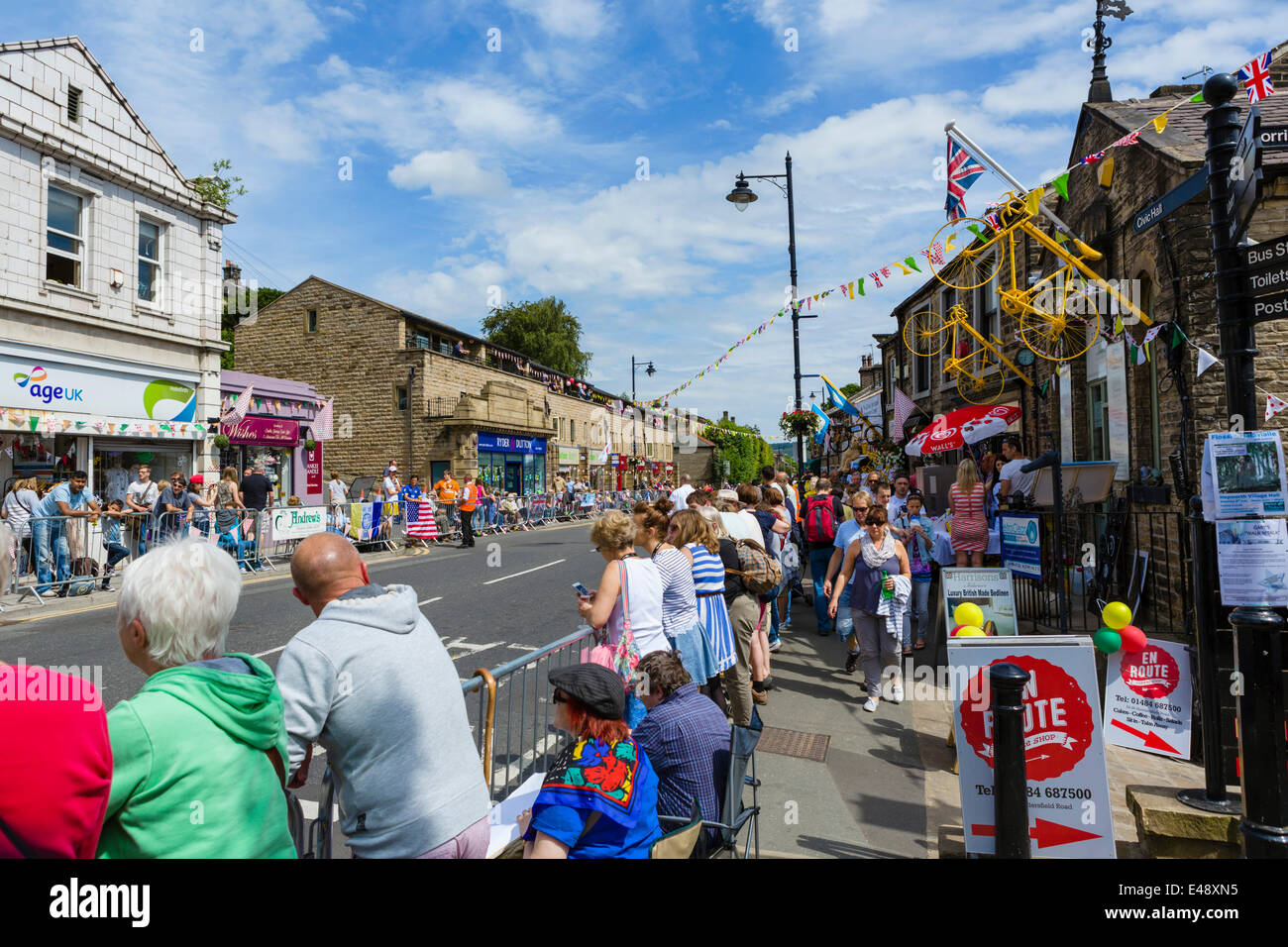 Crowds along the route of stage 2 of the 2014 Tour de France  in the centre of the West Yorkshire town of Holmfirth, Stock Photo