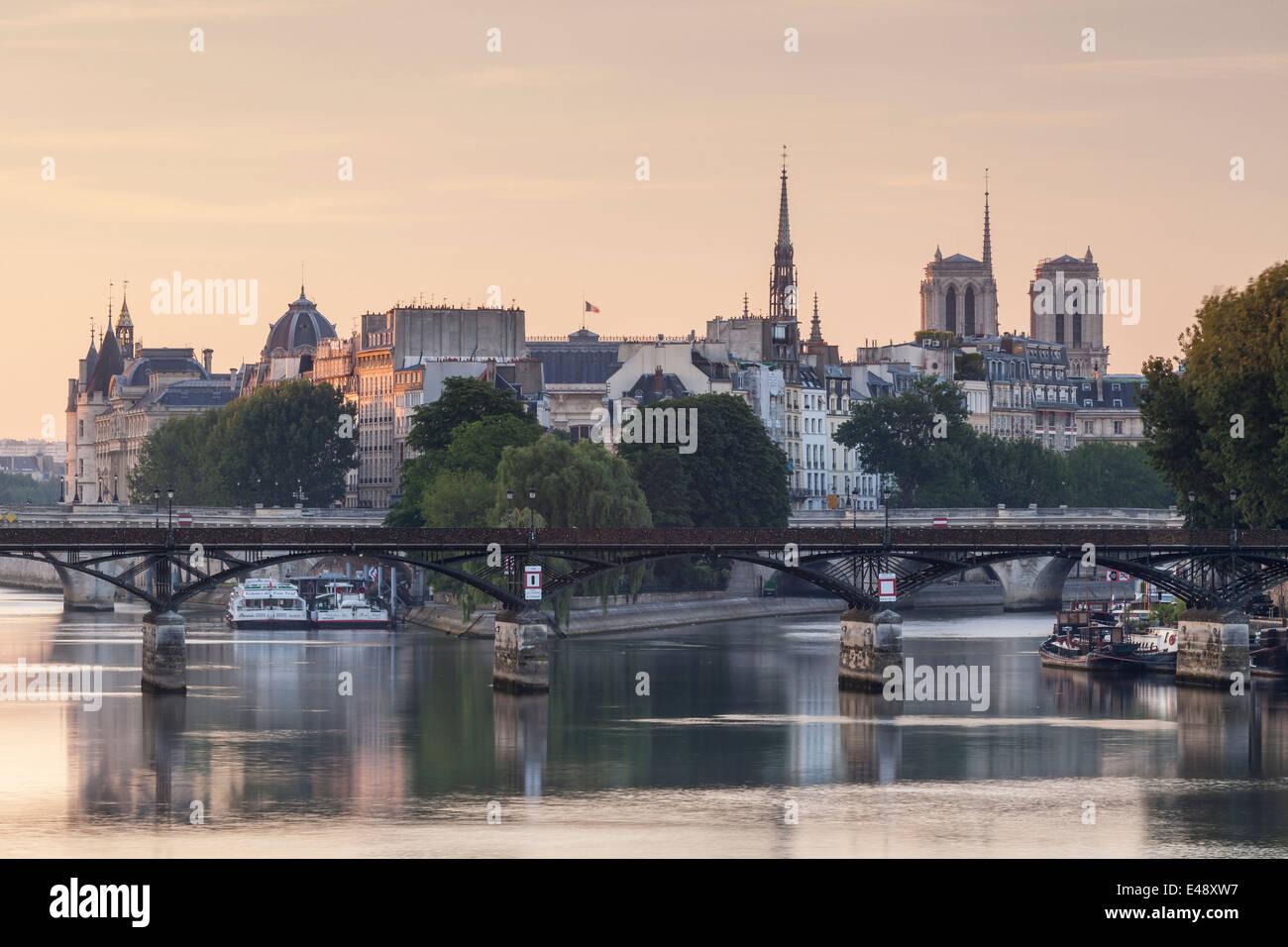 The Pont des Arts with Ile de la Cite in the background. The Ile is home to monuments such as Notre Dame de Paris - Stock Image