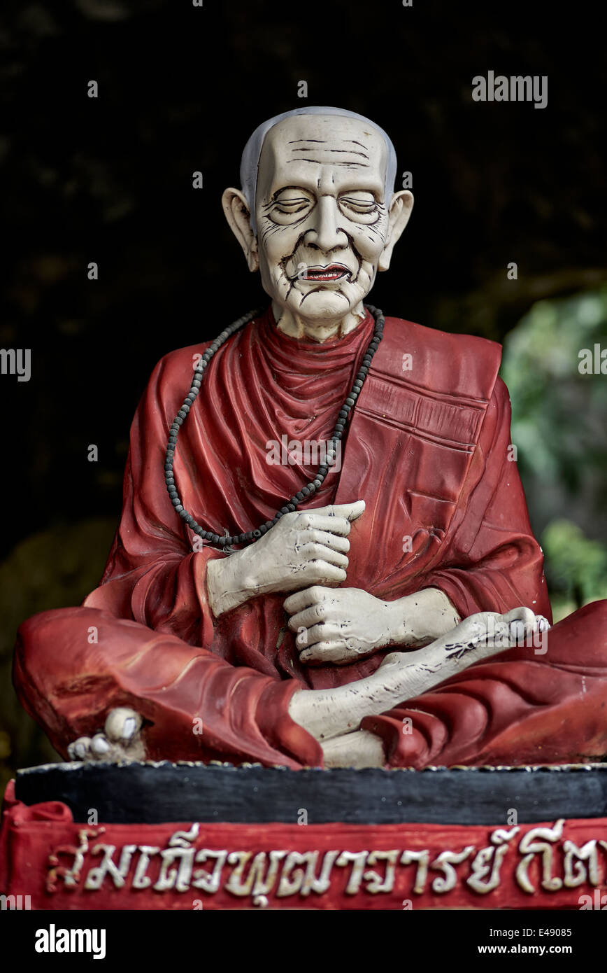 Ornate carving of a revered Monk in the caves at Khao Tao Buddhist temple, Hua Hin, Thailand, S. E. Asia - Stock Image