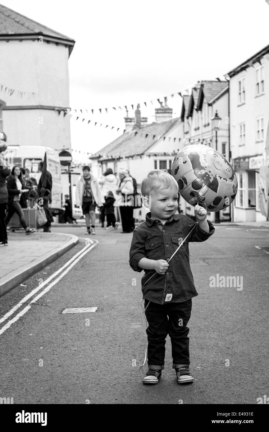 Boy holding Balloon at Mayfair clebration in Torrington - Stock Image