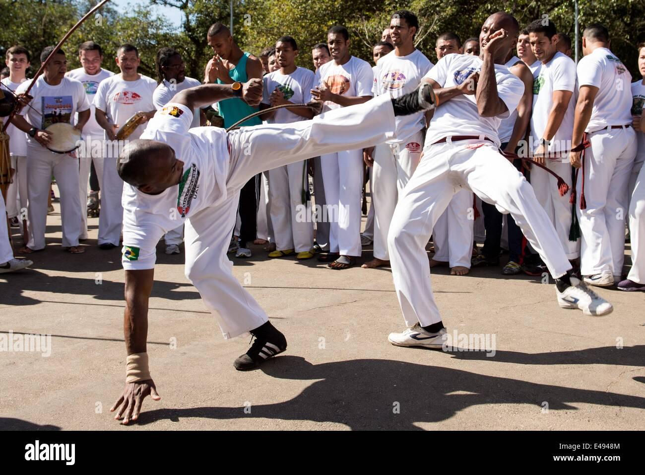 Sao Paulo, Brazil. 06th July, 2014. Brazilian street dancers perform Capoeira at the Ibirapuera Park in Sao Paulo, Stock Photo