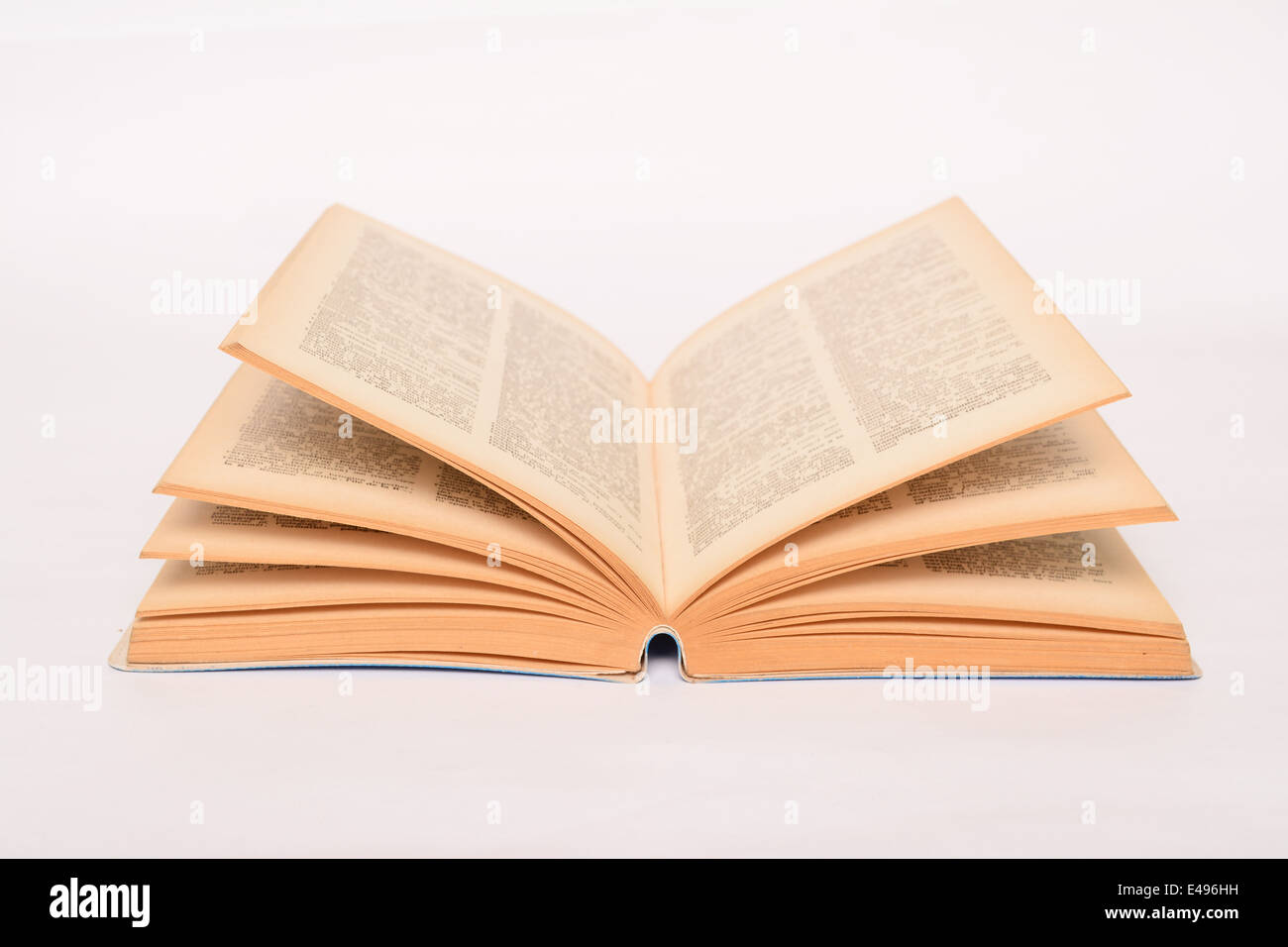 Old open book on white background - Stock Image