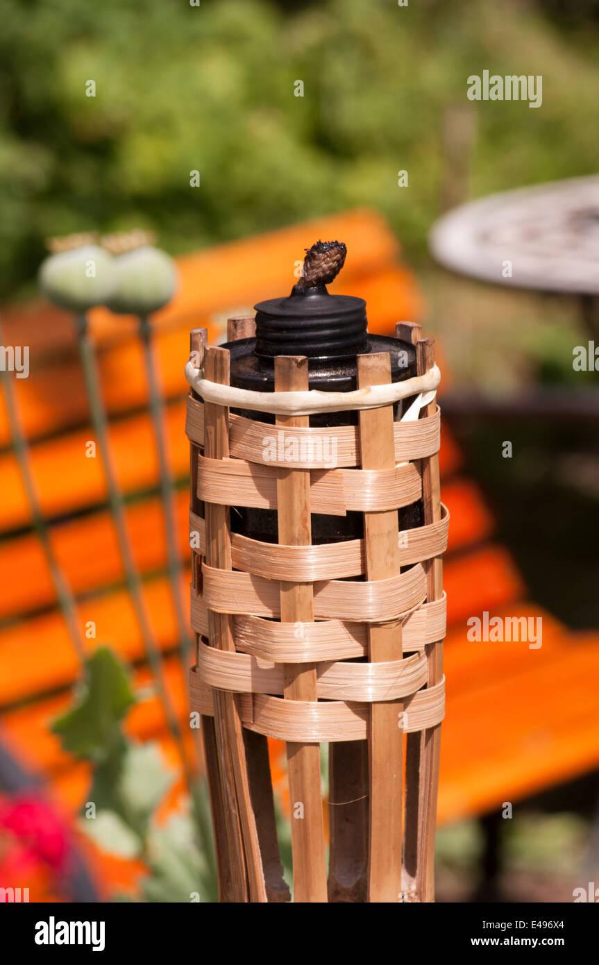 Split Cane Unlit Tiki Garden Oil Lamp Lighting - Stock Image