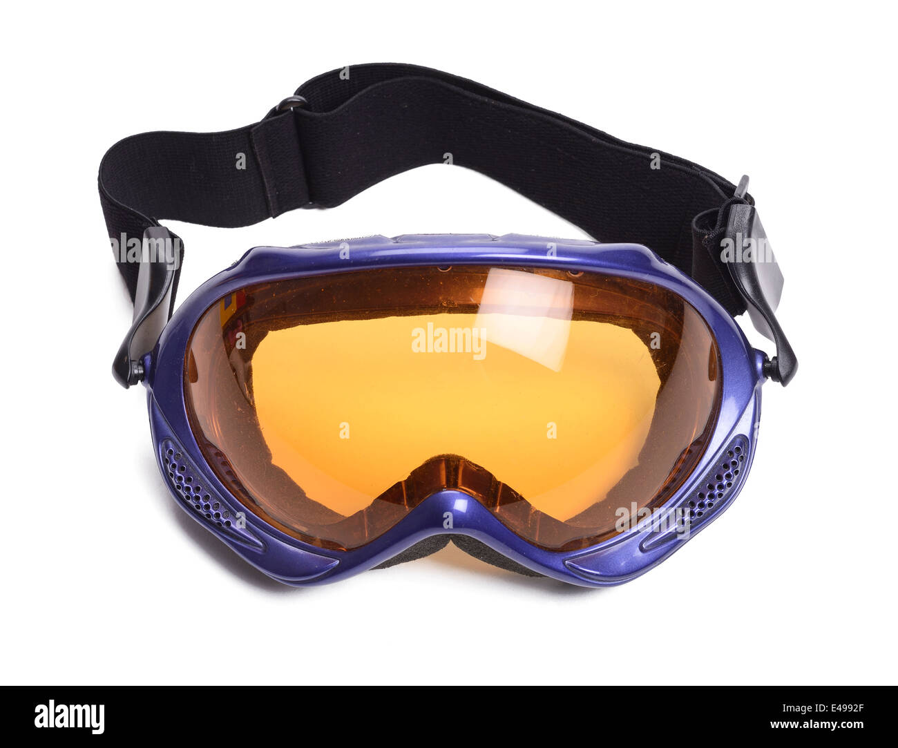 Ski goggles with an orange tinted lens - Stock Image