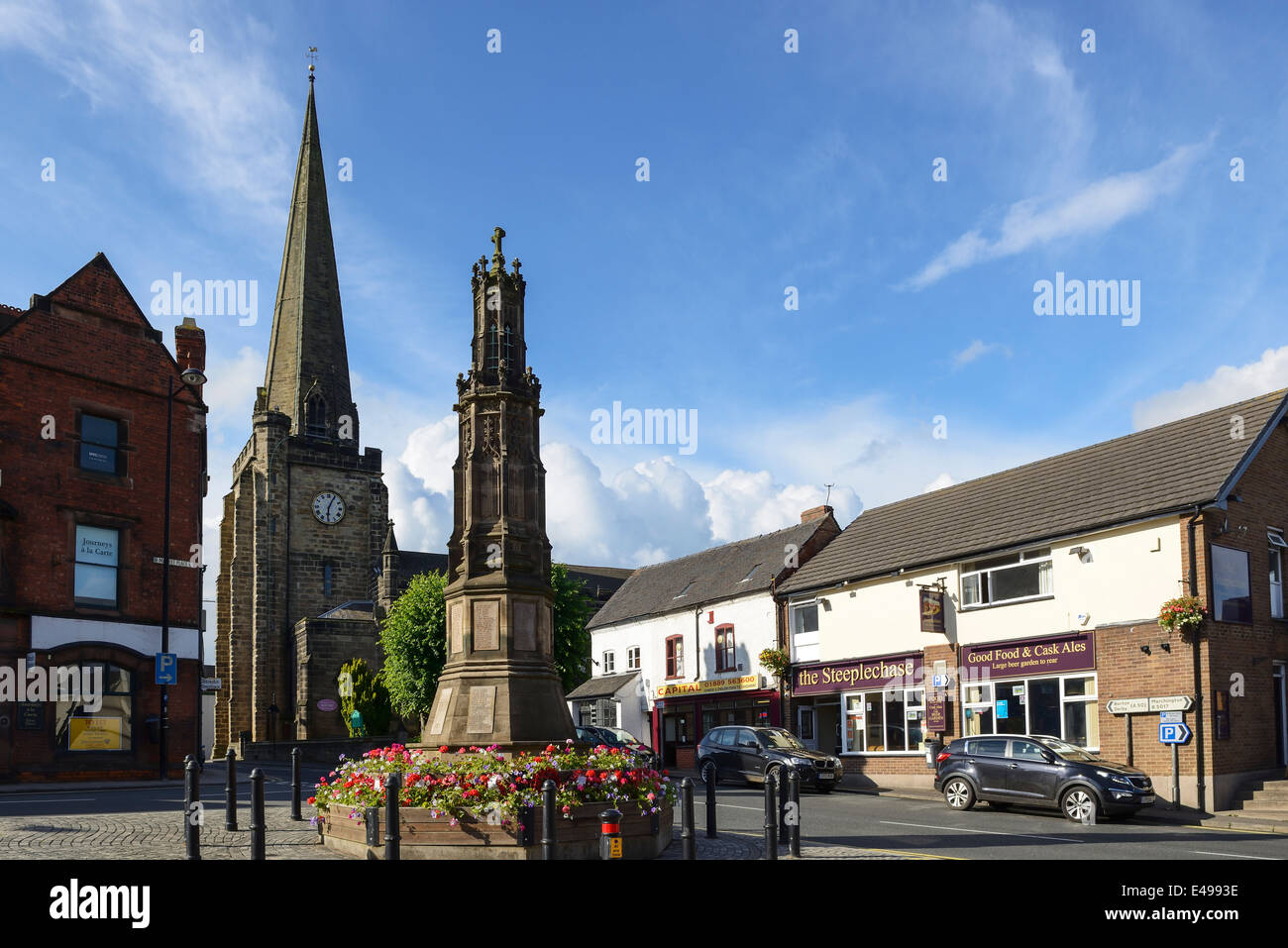 Church spire and the war memorial in Uttoxeter town centre UK - Stock Image