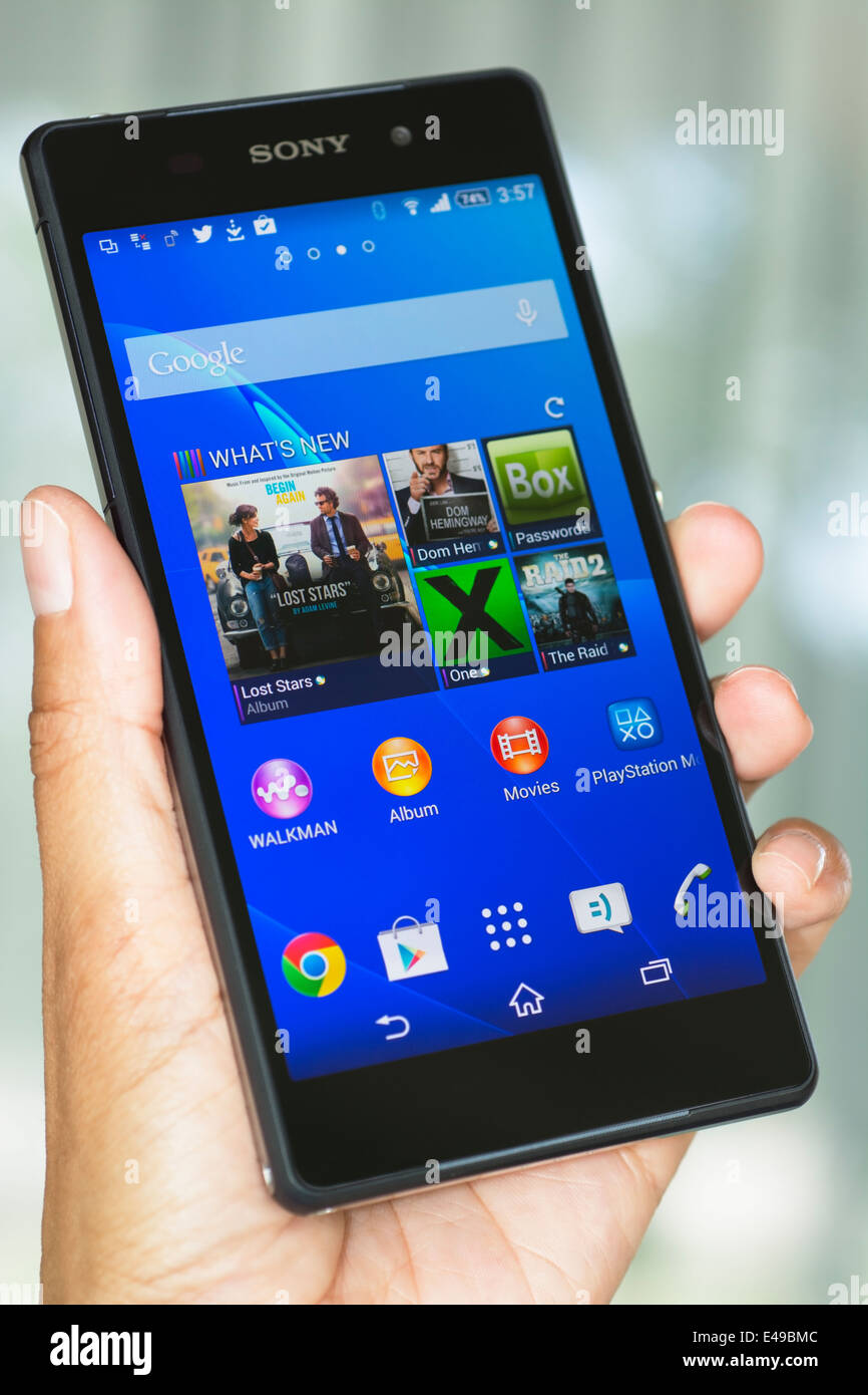 Hand holding Smartphone, Cell, Mobile Phone Xperia Z2 - Stock Image