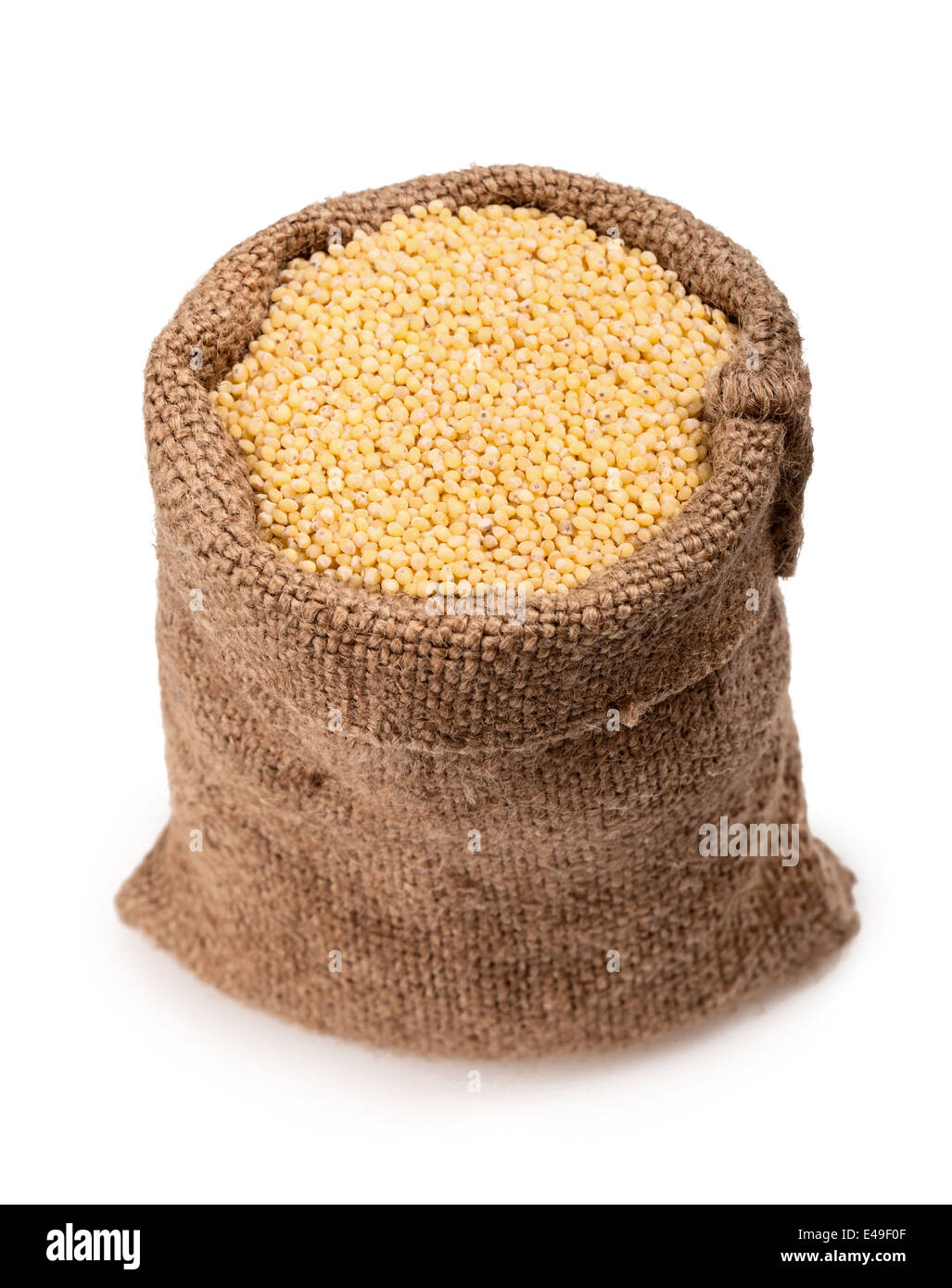 bag of millet on a white background - Stock Image