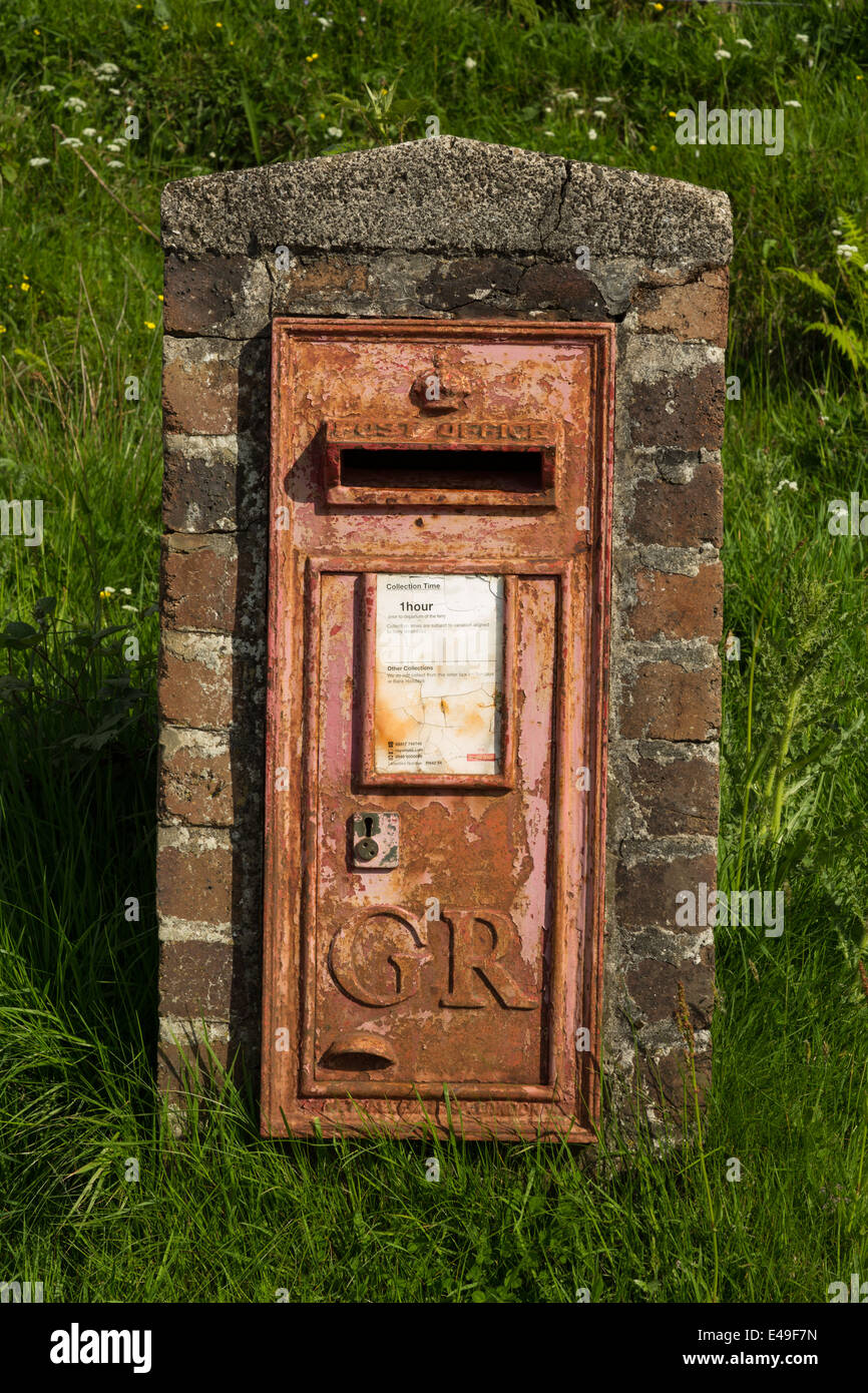 Old rusty GR post box at Cleadale on the Isle of Eigg in Scotland. Stock Photo