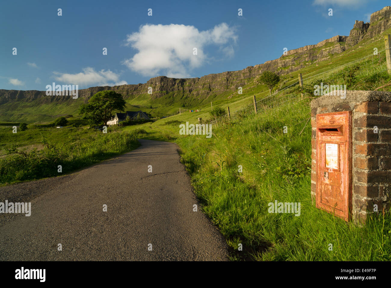 Lageorna and an old red GR Postbox at Cleadale, the isle of Eigg, Inner Hebrides, Scotland - Stock Image