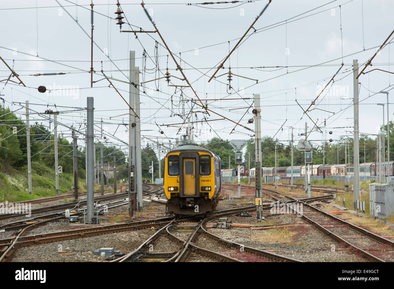 Diesel Multiple Unit (DMU) Class 156 operated by Northern Rail approaching Carnforth Station, Lancashire - Stock Image