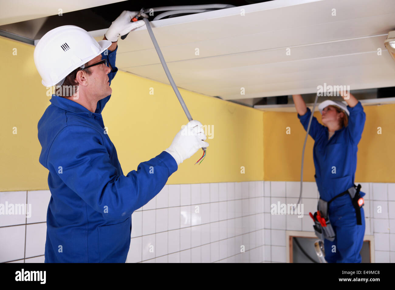Electricians Wiring Bathroom Stock Photos In Two Repairing Ceiling Image