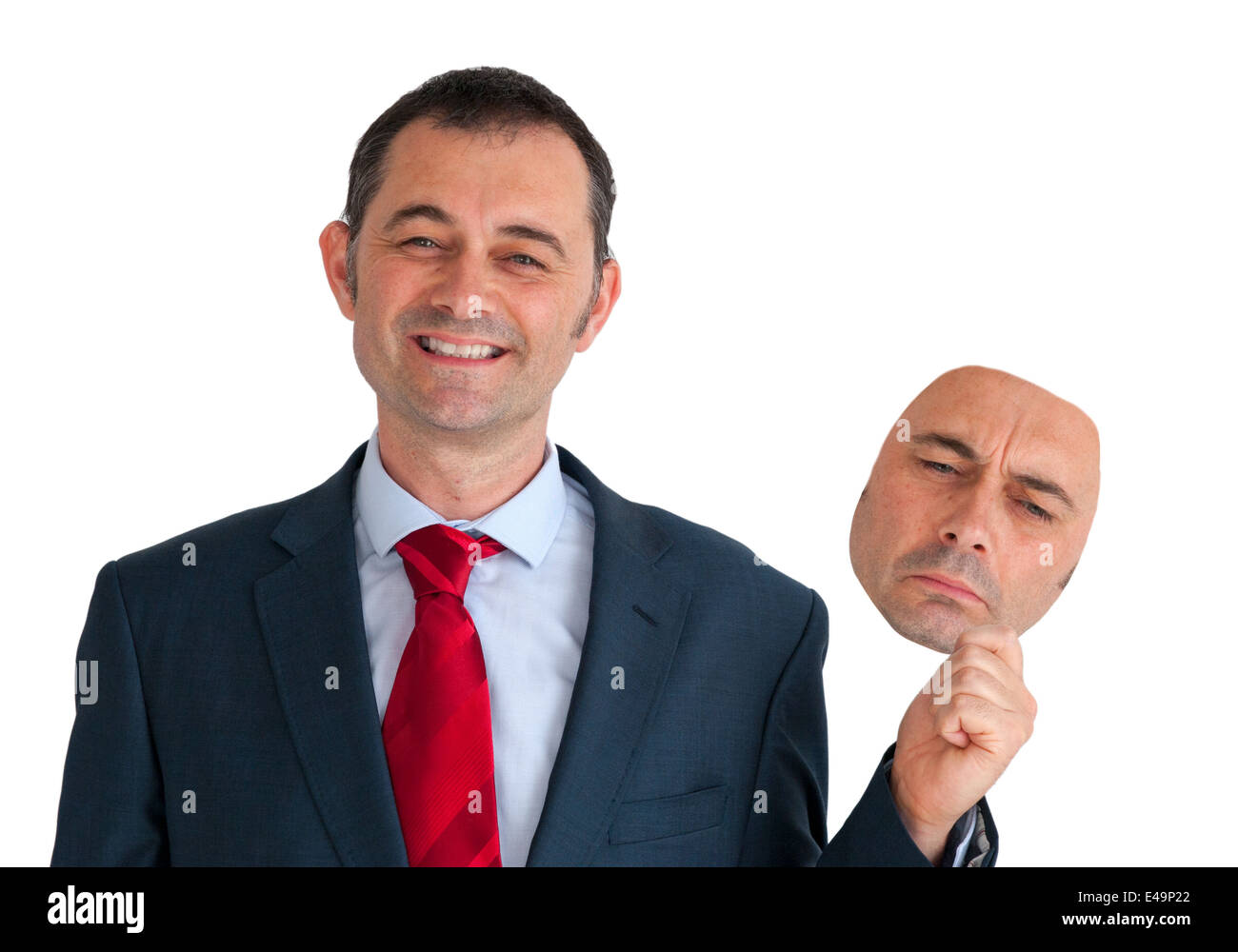 businessman concealing depression with a happy mask - Stock Image
