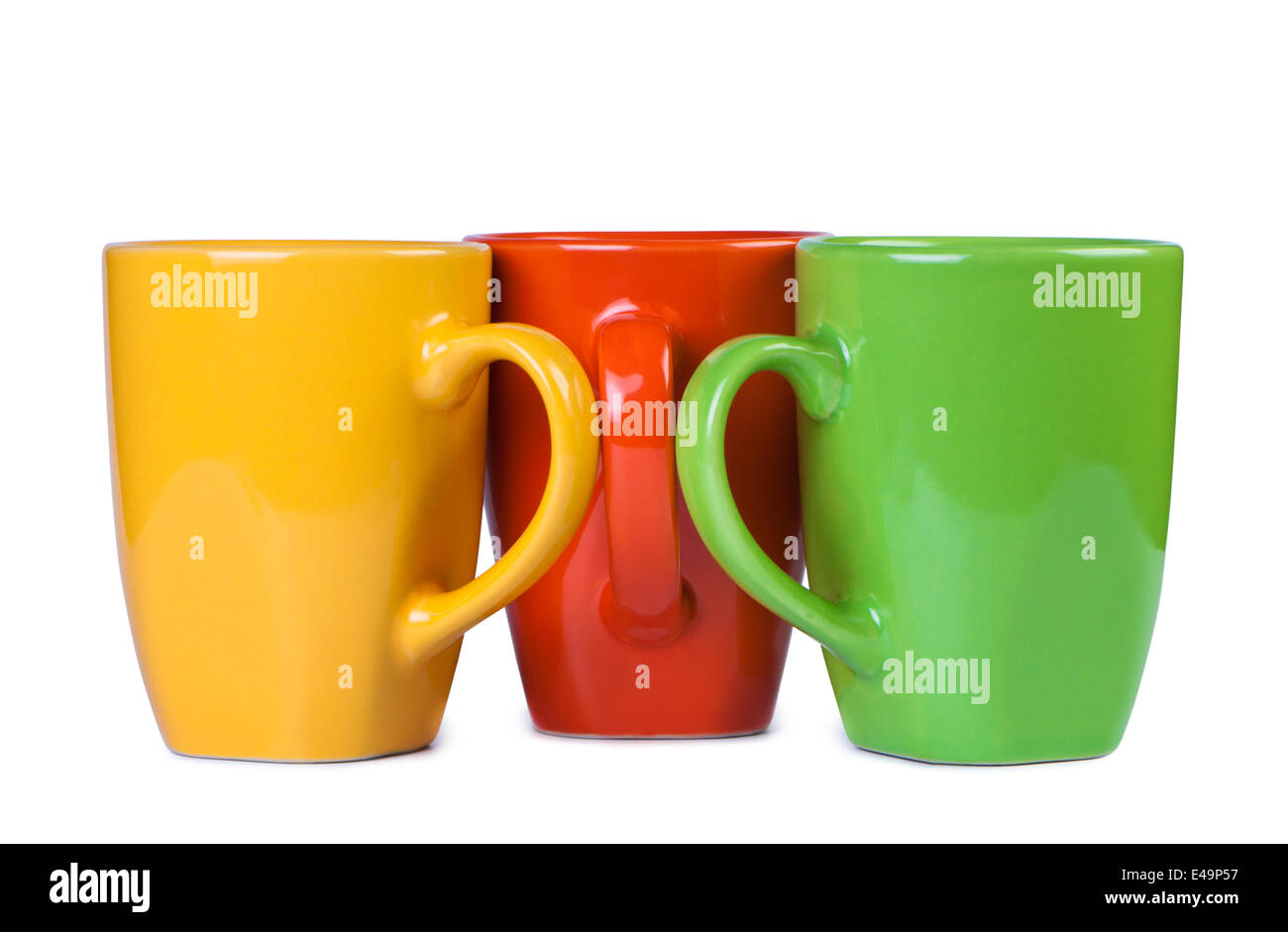 Three multi-colored cups. - Stock Image