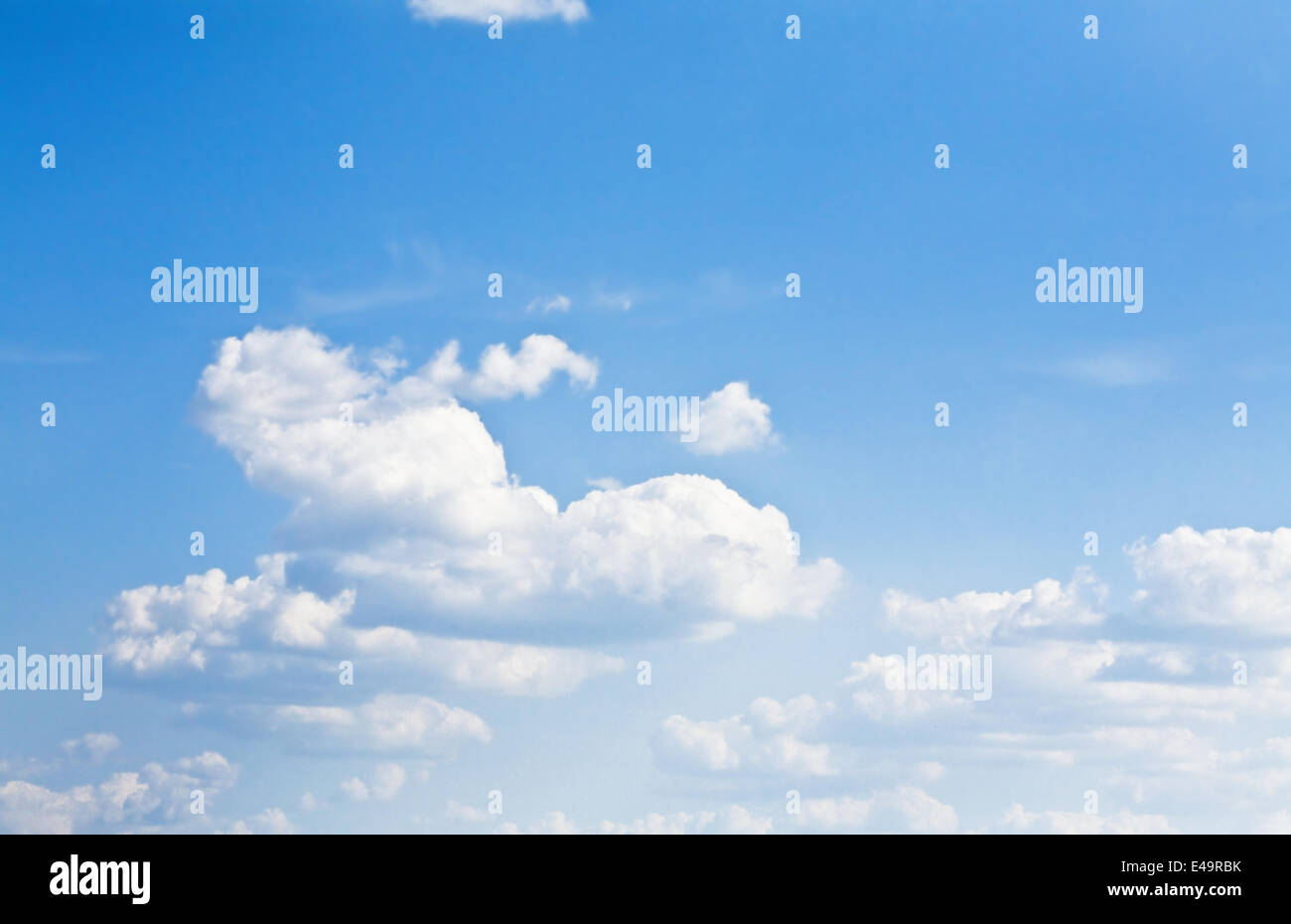 cumulus clouds soaring on the blue sky - Stock Image