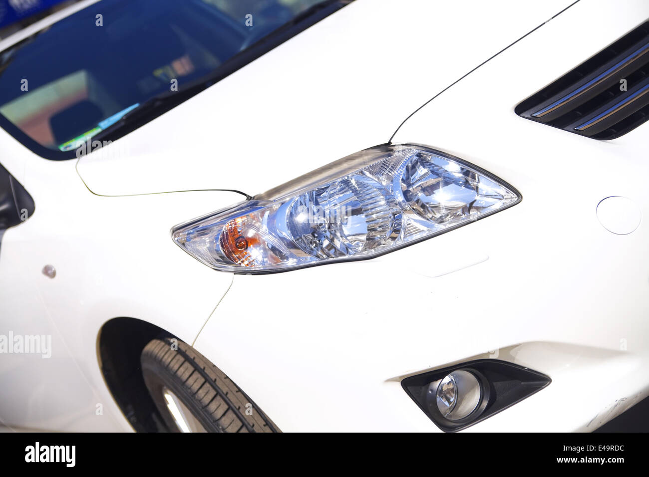 front view of modern white passenger car - Stock Image