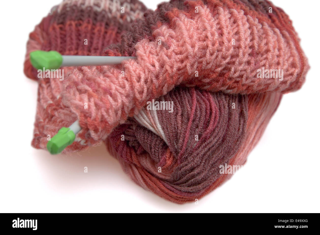 Incomplete a knitted scarf of claret color - Stock Image