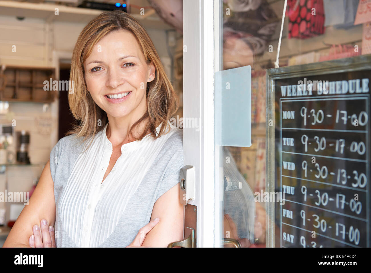 Owner Of Gift Shop Standing In Doorway - Stock Image