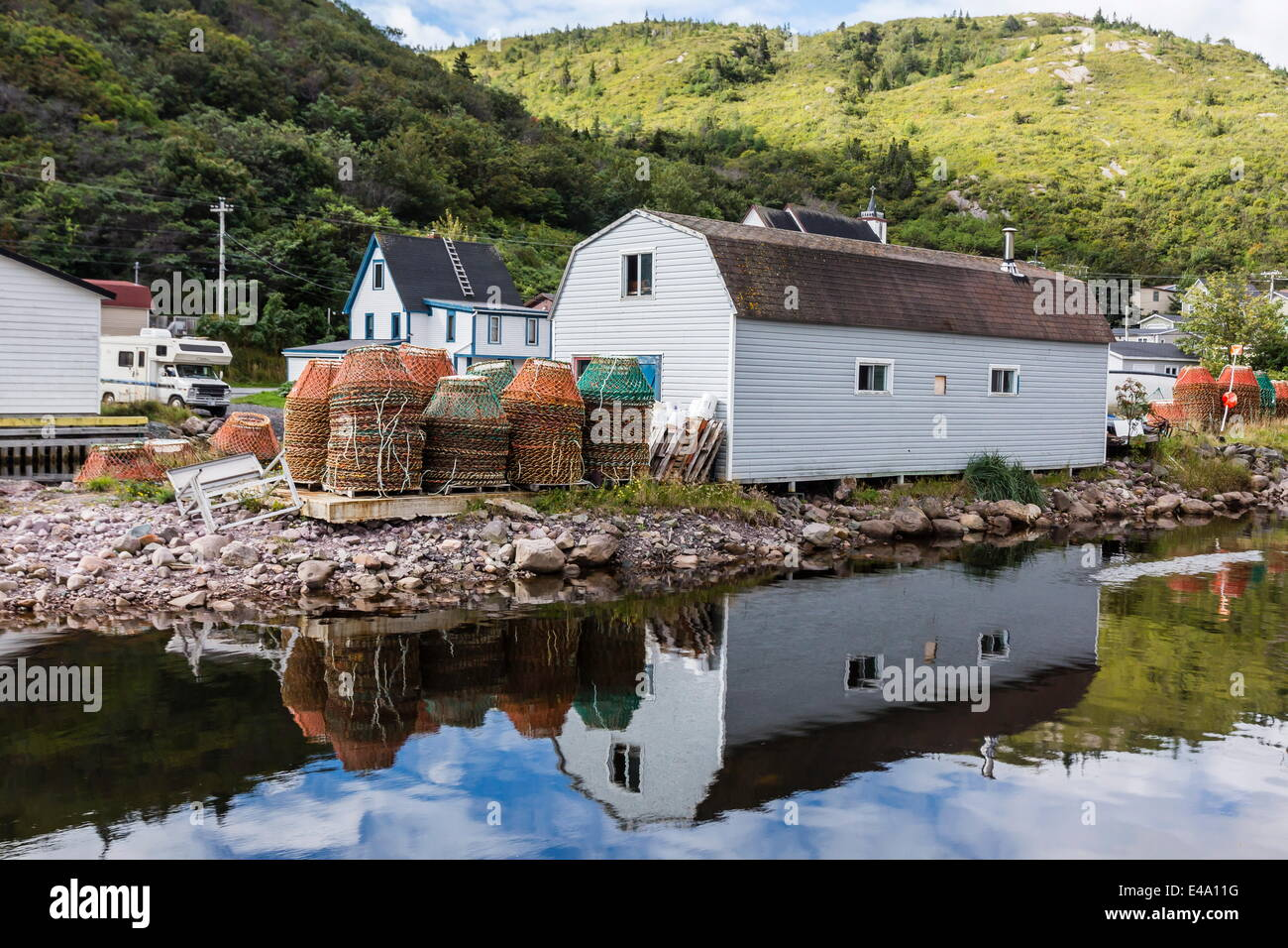 Small harbour with lobster traps outside St. John's, Newfoundland, Canada, North America - Stock Image