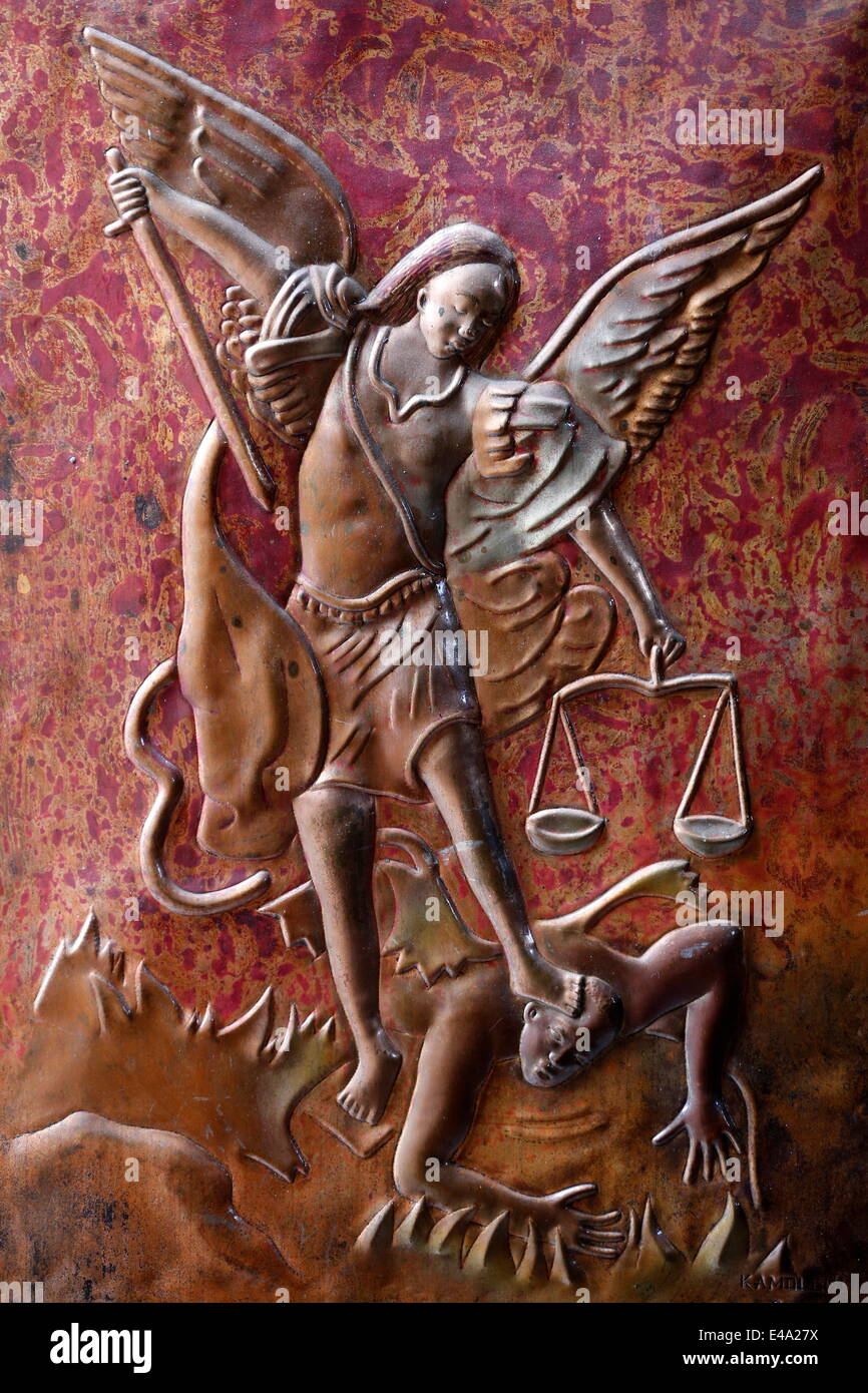 Depiction of the Archangel St. Michael slaying the dragon, St. Anne's Basilica, Brazzaville, Congo, Africa - Stock Image