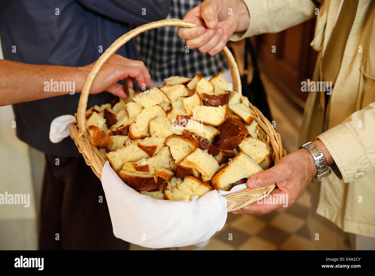 Distribution of blessed bread, St. Hubert's Mass, Notre Dame du Hamel, Eure, France, Europe - Stock Image