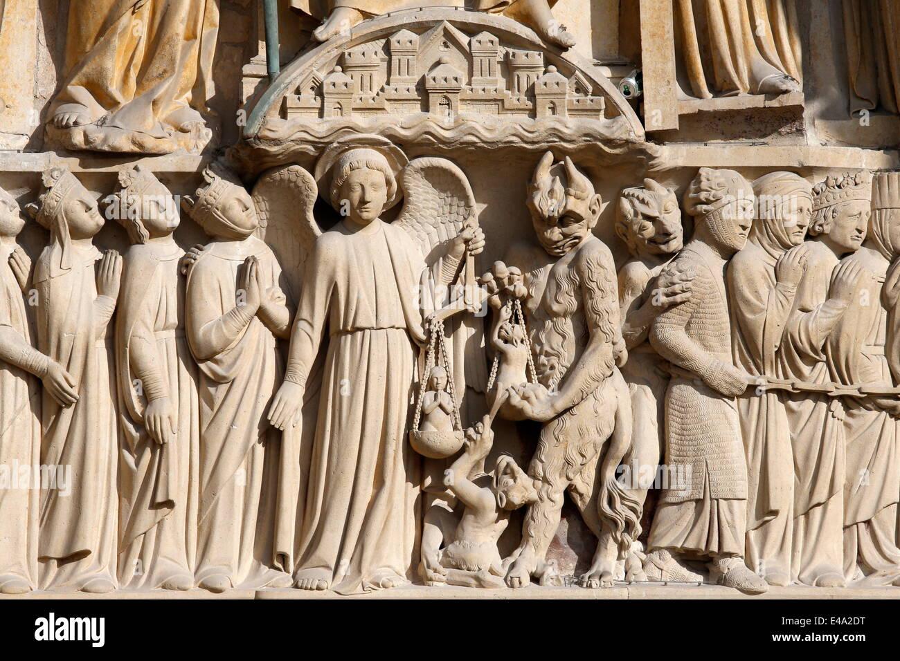 St. Michael weighing the souls, Portal of the Last Judgement, Western facade, Notre Dame de Paris Cathedral, Paris, - Stock Image