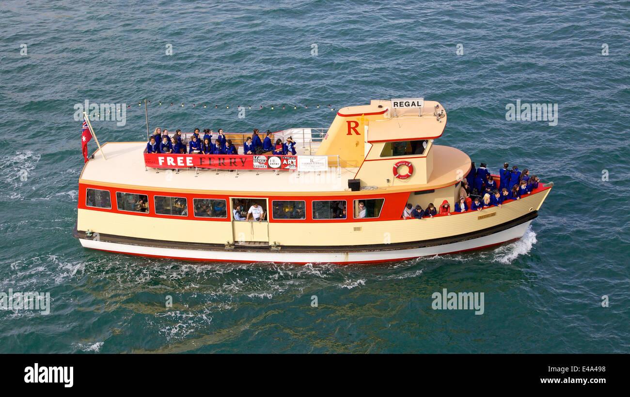 Passengers aboard a ferry in Sydney Cove, near Circular Quay in Sydney, Australia. - Stock Image
