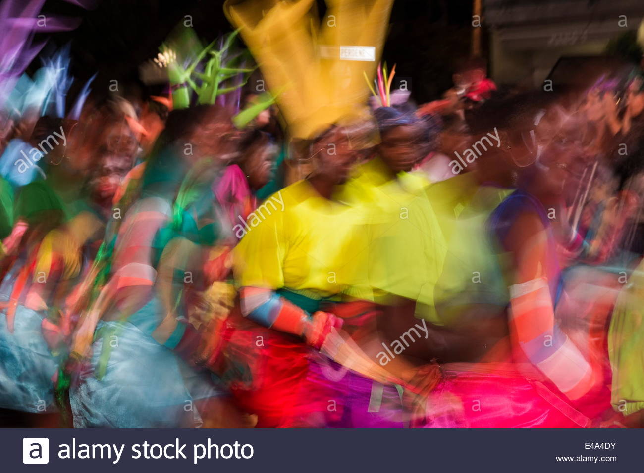 blurred movement and color of dancers in motion at cape carnival