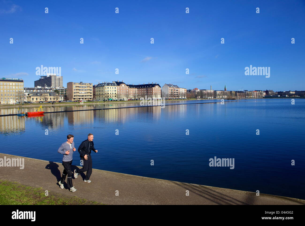 Joggers along Sortedams So (Sortedams Lake), Copenhagen, Denmark, Scandinavia, Europe - Stock Image