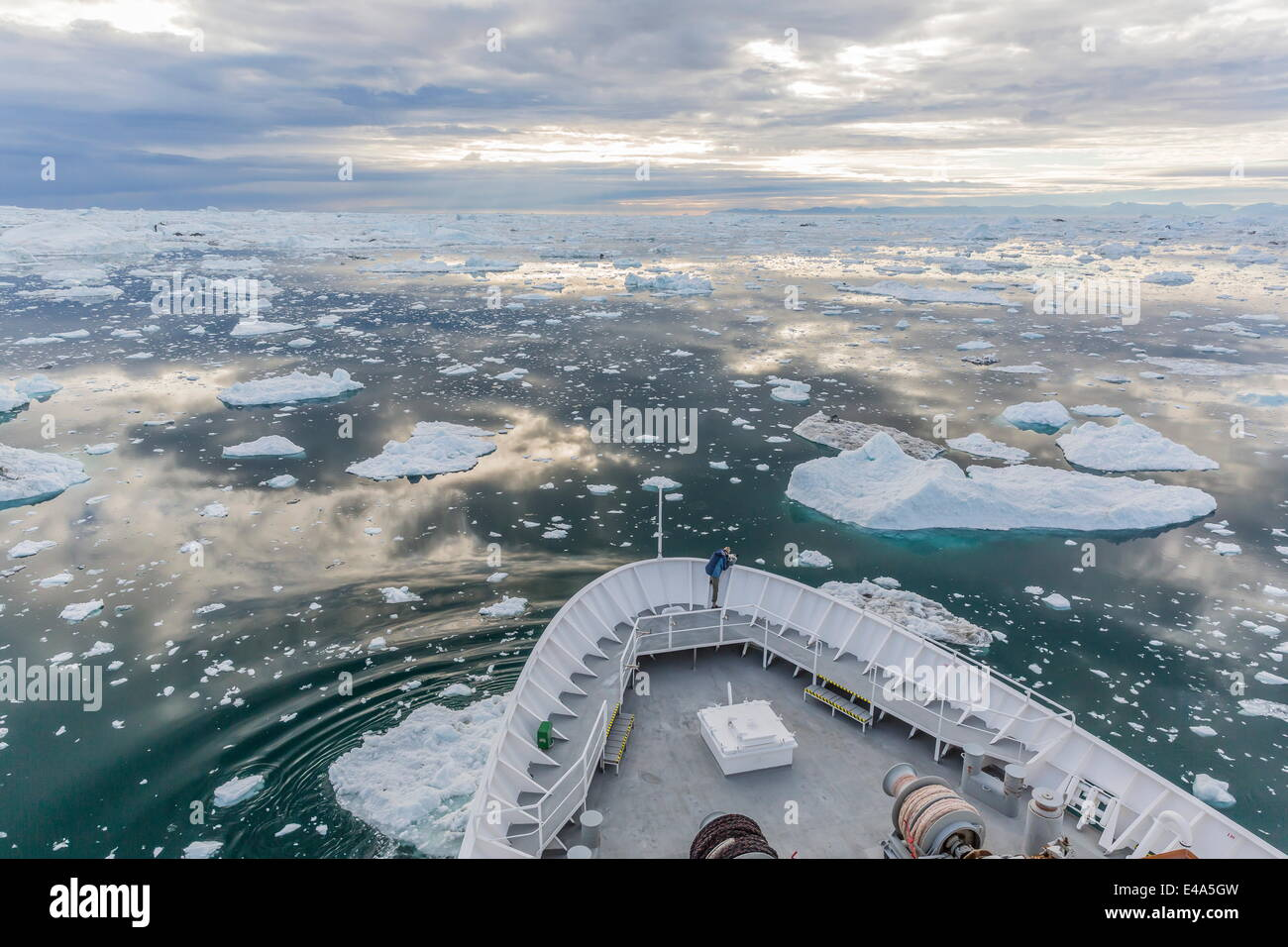 Expeditions ship amongst huge icebergs, Ilulissat, Greenland, Polar Regions - Stock Image
