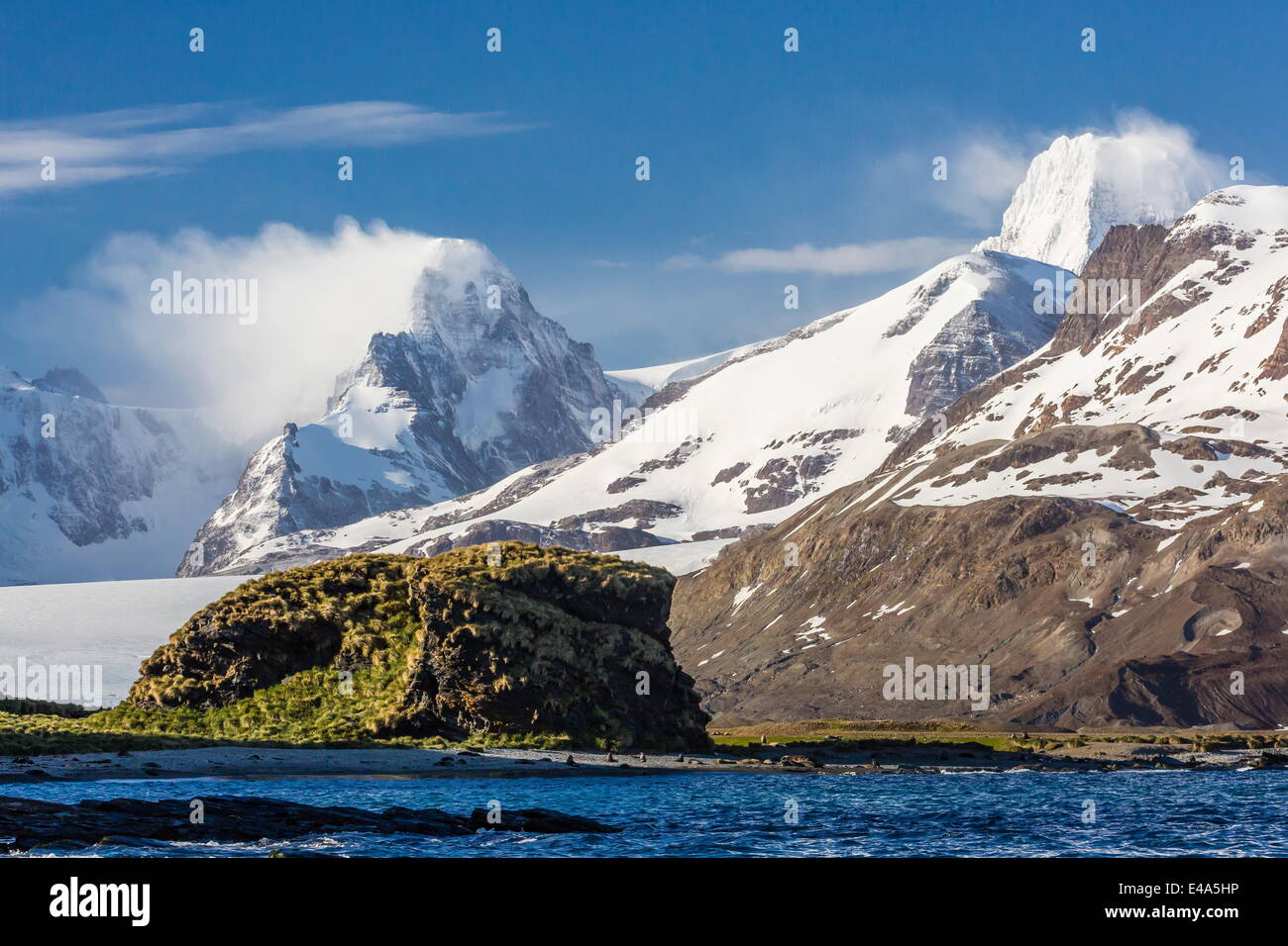 Misty clouds shroud snow-covered peaks in Fortuna Bay, South Georgia, UK Overseas Protectorate, Polar Regions - Stock Image