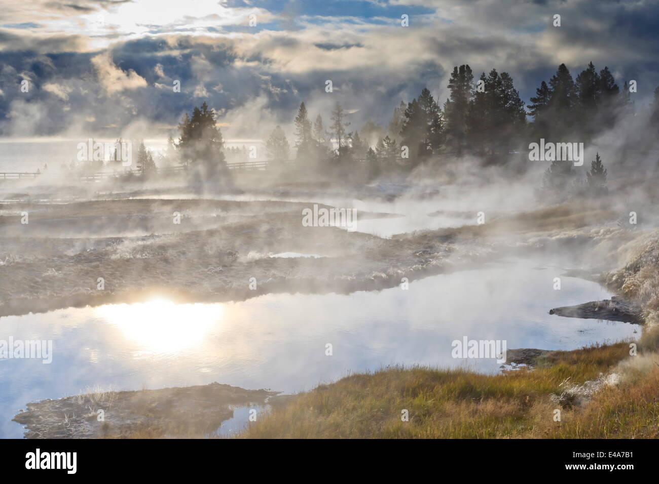 Freezing mists and thermal features, dawn, West Thumb Geyser Basin, Yellowstone National Park, UNESCO, Wyoming, - Stock Image
