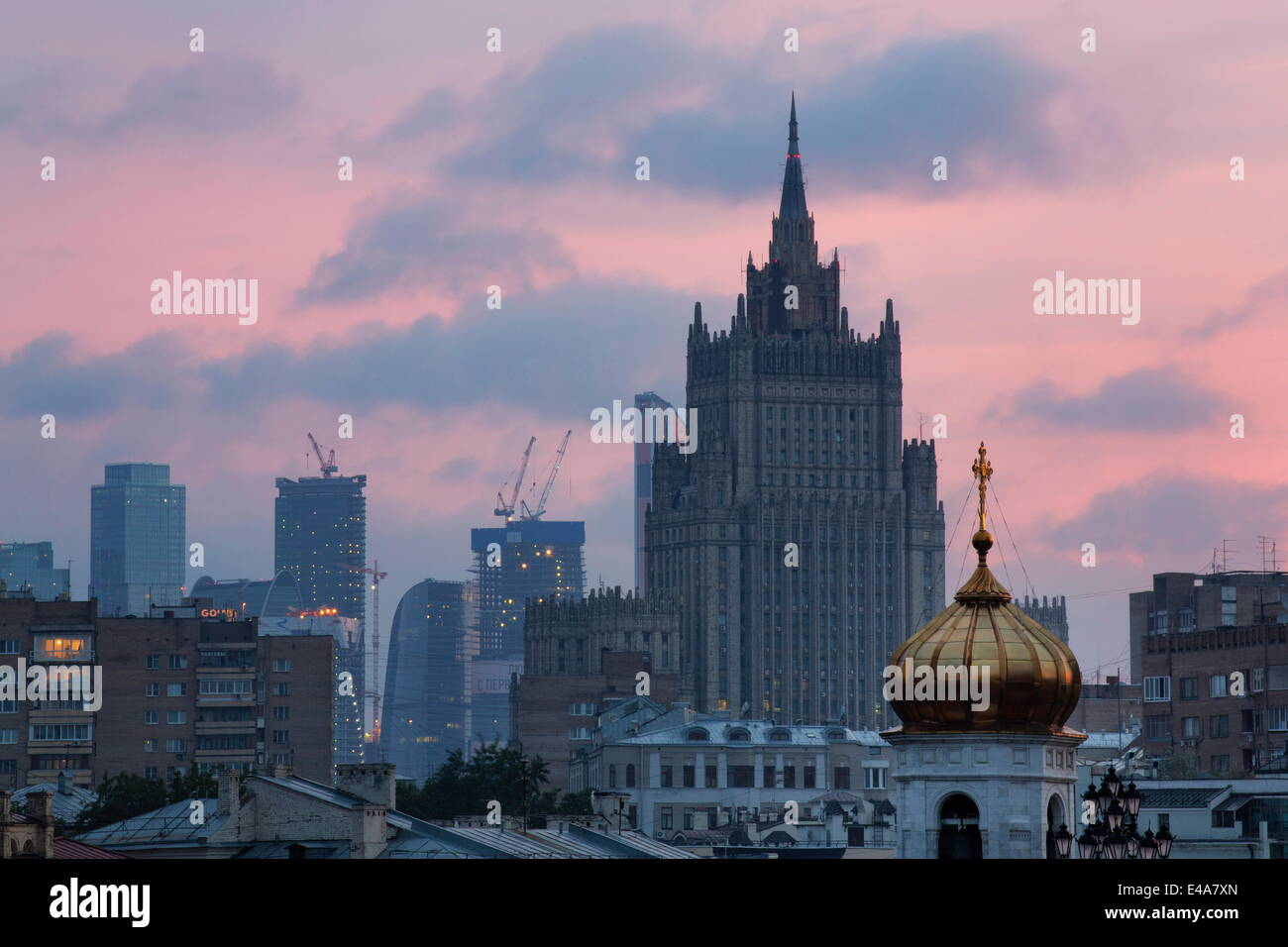 Moscow skyline at dusk with Stalanist-Gothic skyscraper, Moscow, Russia, Europe - Stock Image