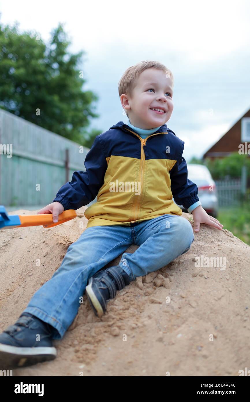 Little Boy Sitting On Sand Stock Photos & Little Boy