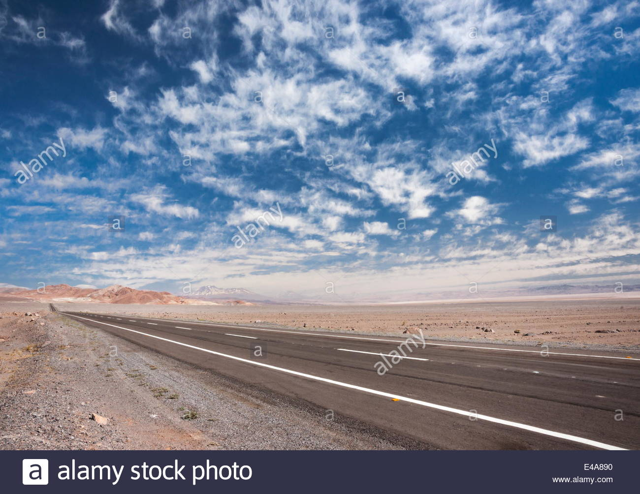Open paved road with no traffic in Atacama Desert, Chile, South America Stock Photo