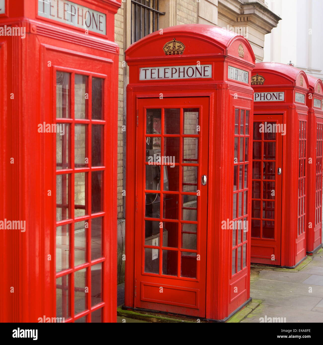 Row of red telephone booths design by Sir Giles Gilbert Scott, near Covent Garden, London, England, United Kingdom, - Stock Image