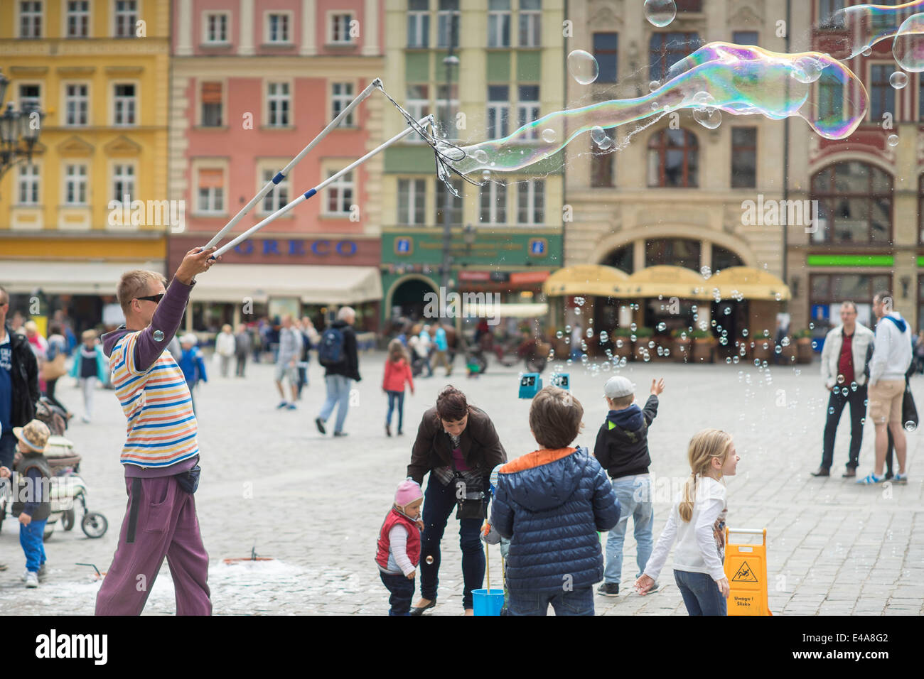 The Man letting soap bubbles Old Market Wroclaw - Stock Image