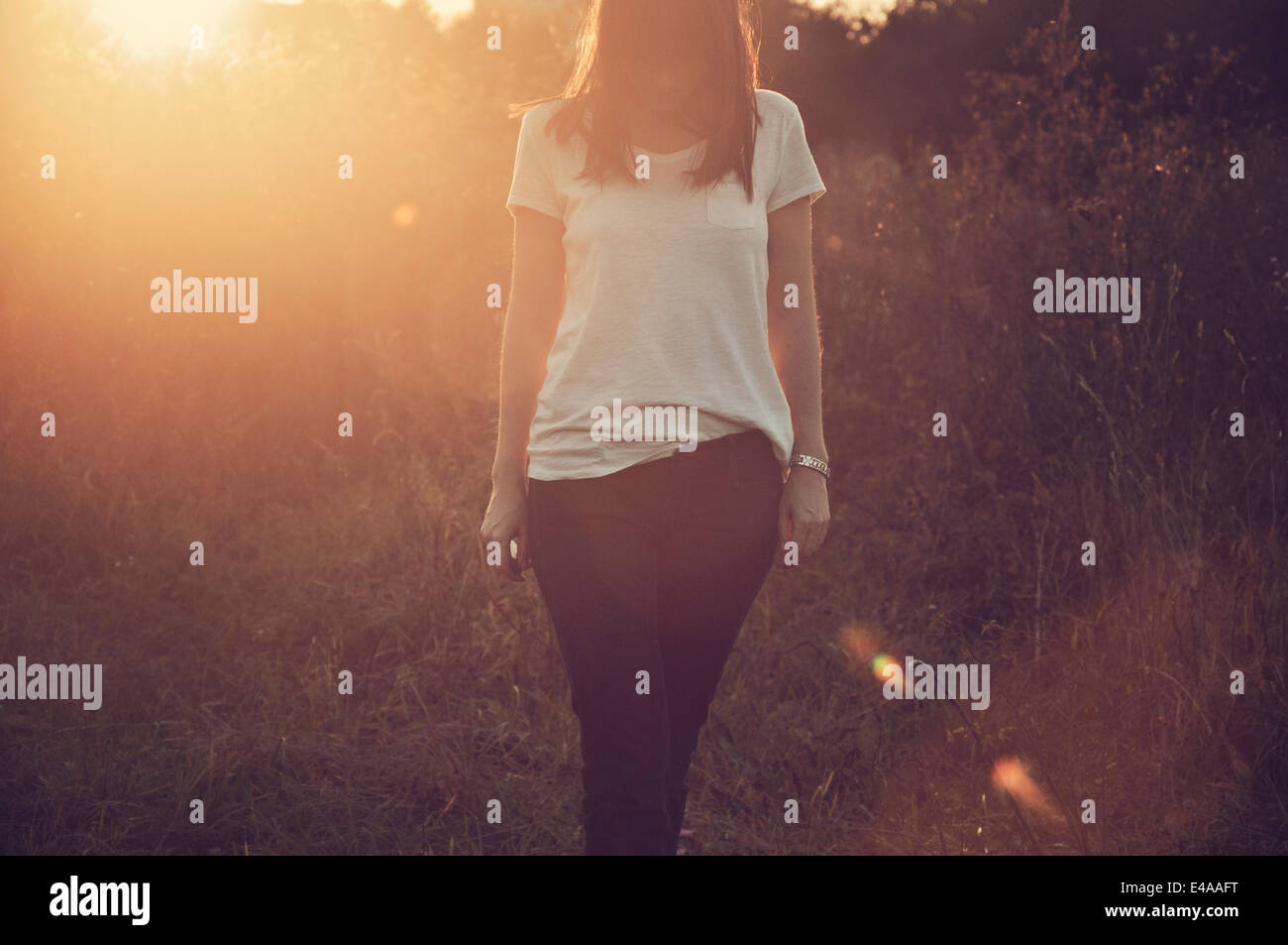 Mid adult woman standing in field Stock Photo