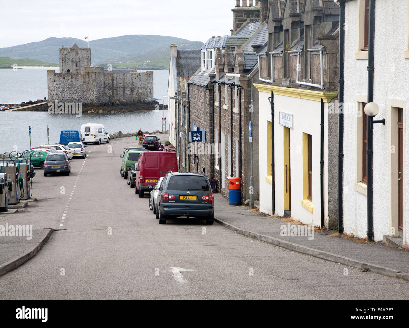 Street shops and Kisimul castle Isle of Barra, Outer Hebrides, Scotland - Stock Image