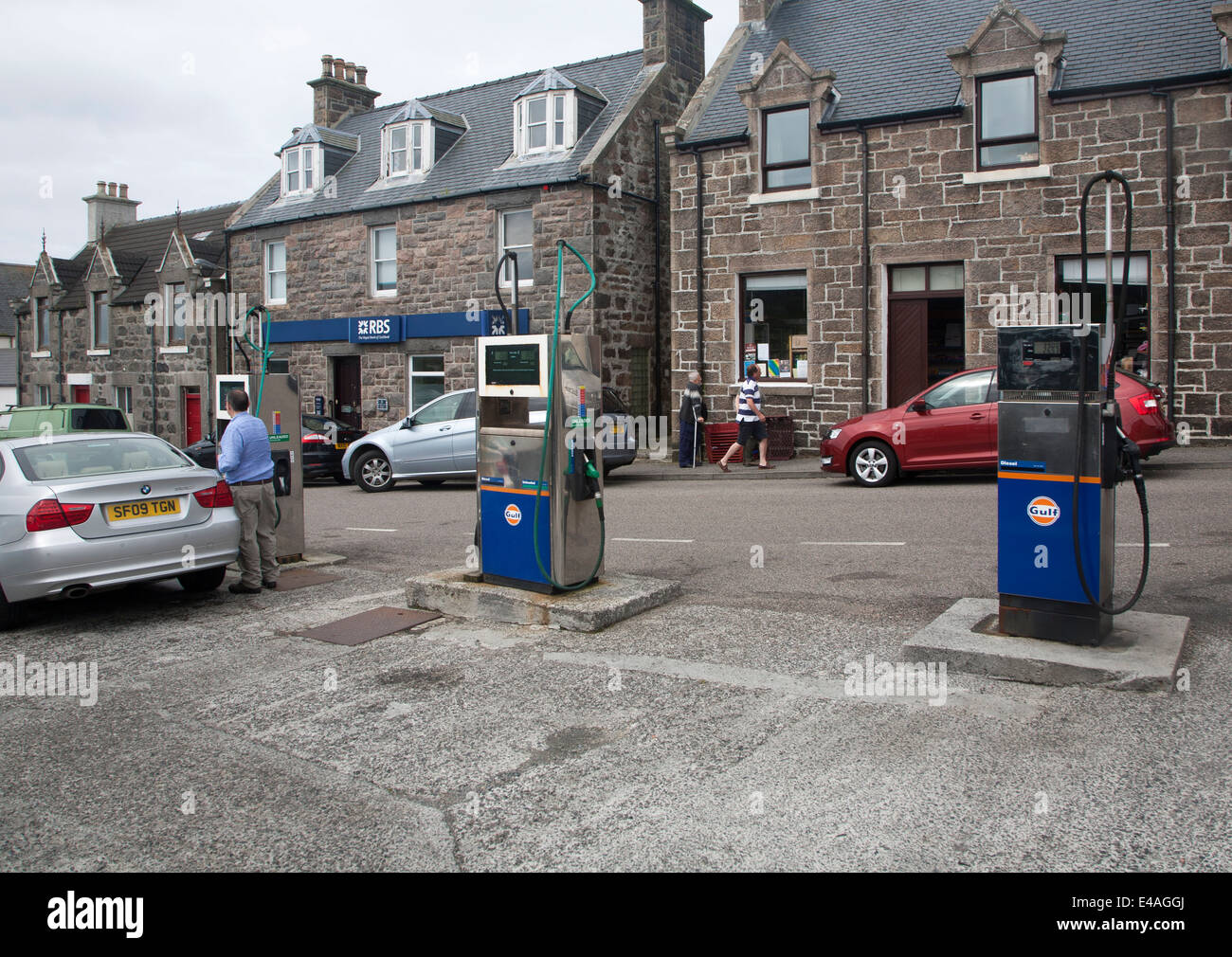 Petrol pumps and shops Castlebay Isle of Barra, Outer Hebrides, Scotland - Stock Image