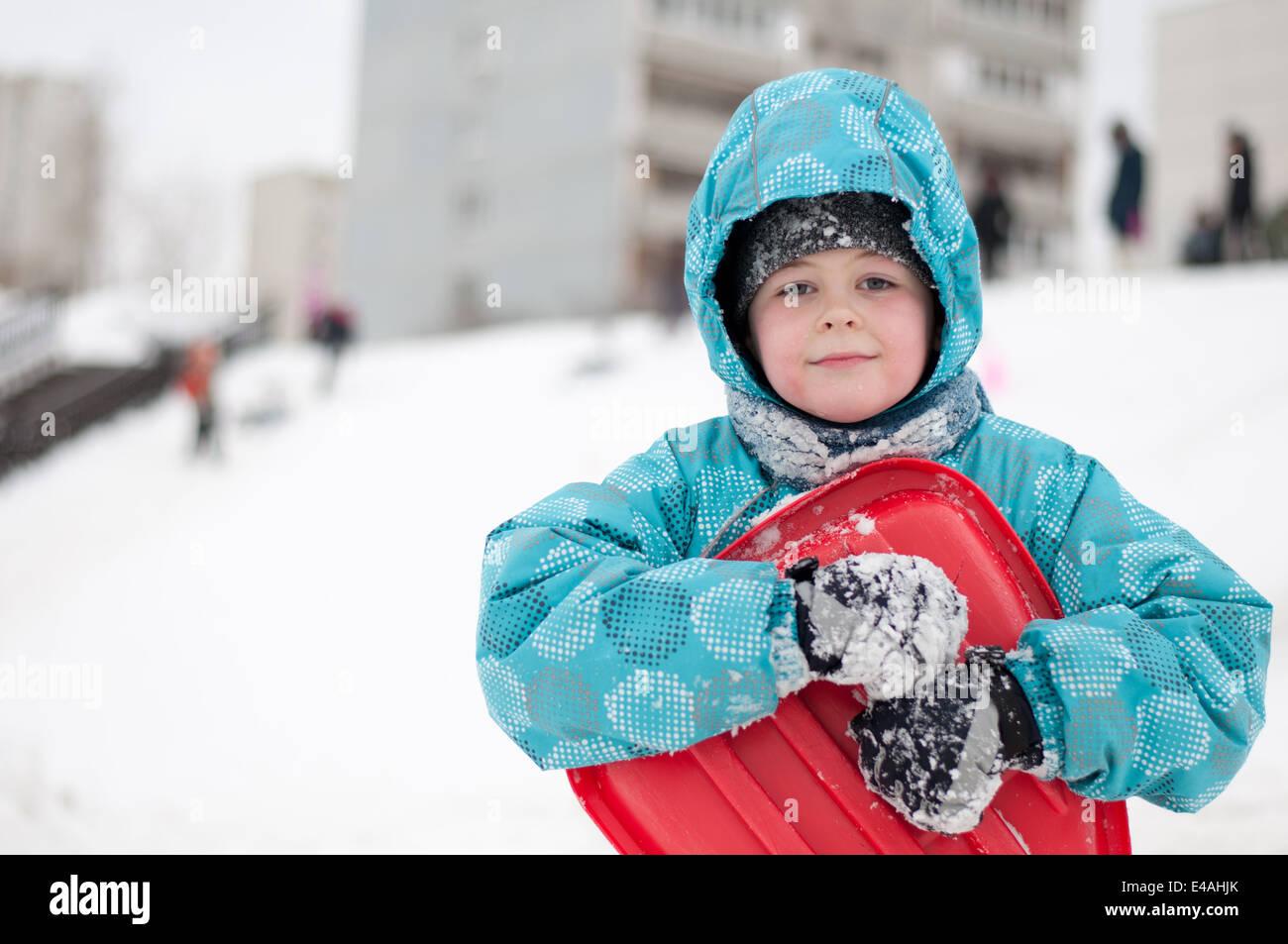 child winter kid sled snow activity cheerful