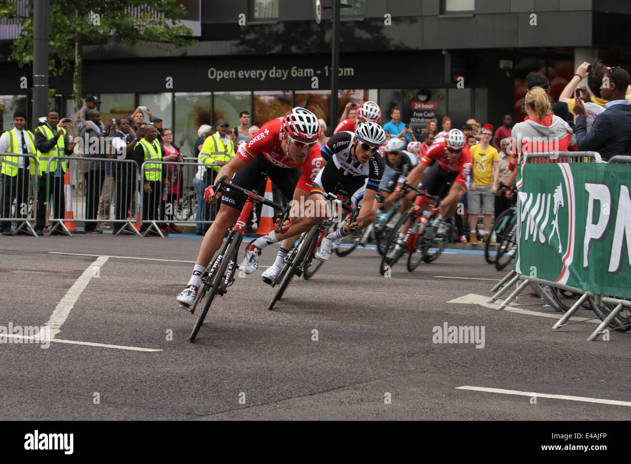 London, UK. 07th July, 2014. Rides make their way through Stratford High  on Stage 3 of the Tour de France via Newham. - Stock Image