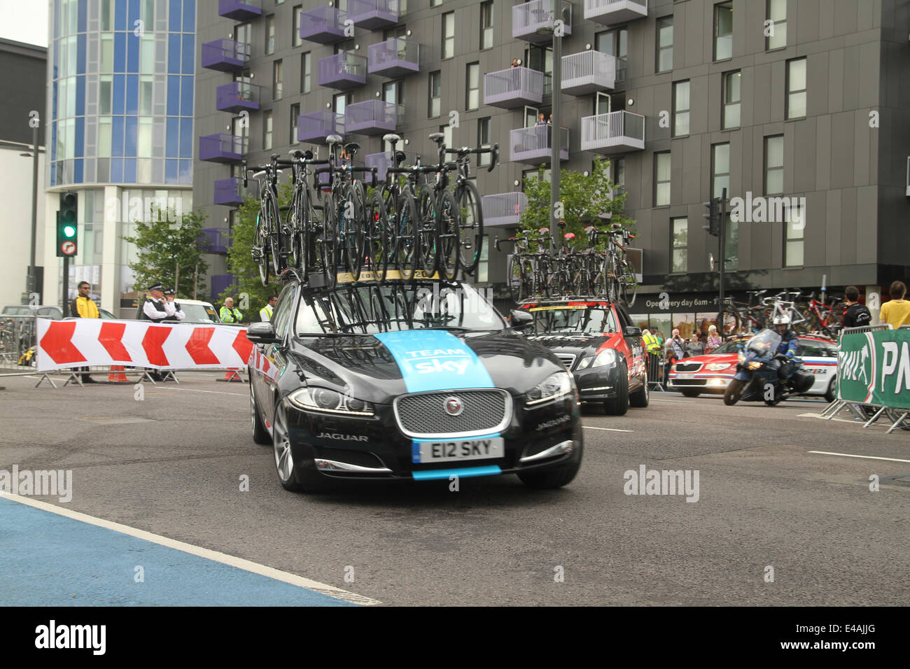 London, UK. 07th July, 2014. London, UK. 07th July, 2014. Sky Team broom wagon​ races after the rides on Stratford - Stock Image