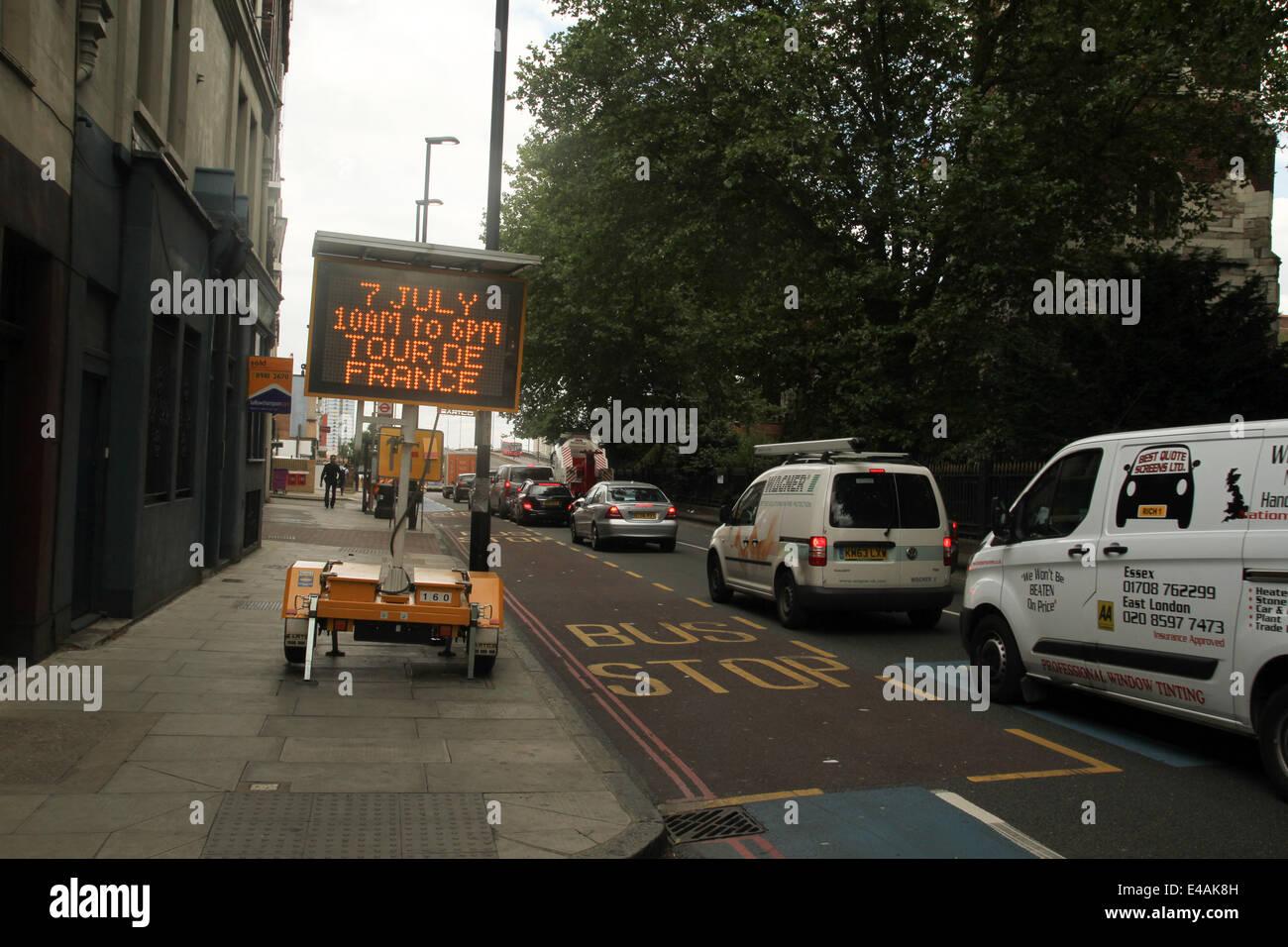 London, UK. 07th July, 2014. Rides make their way through Stratford High Street and onto West Ham Lane on Stage - Stock Image