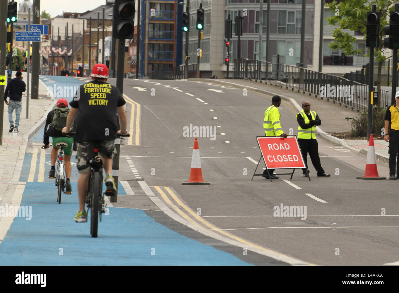 London, UK. 07th July, 2014. Fun rides make their way through a closed Stratford High Street before the Tour de - Stock Image