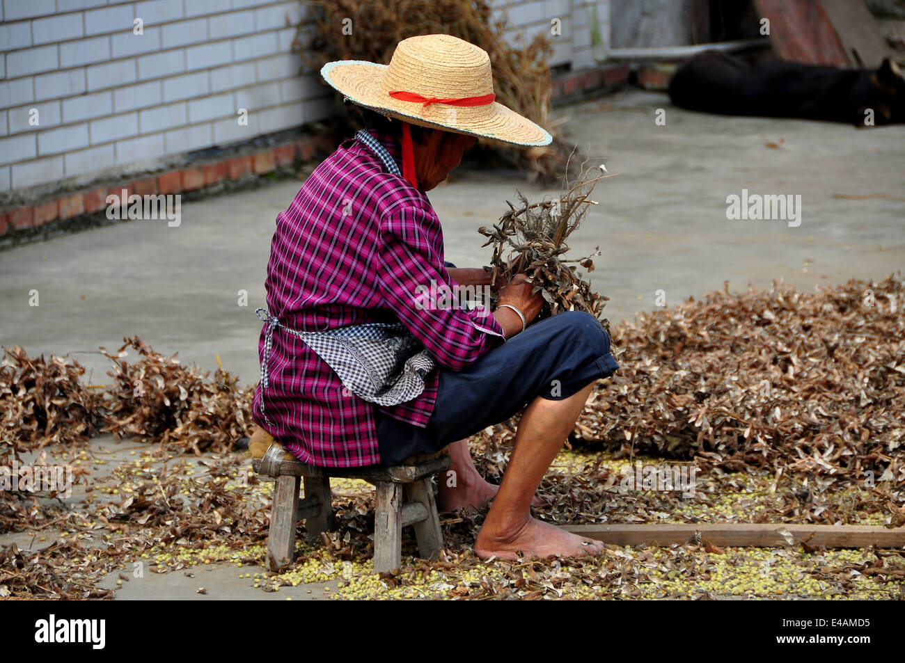 Wondrous Pengzhou China A Woman Sitting On A Small Stool In The Gmtry Best Dining Table And Chair Ideas Images Gmtryco