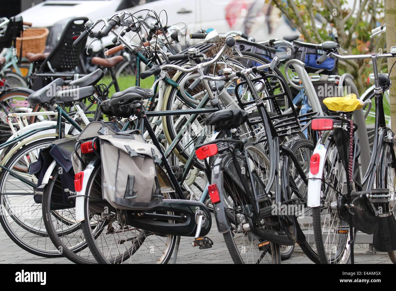 Many bikes on sidewalk Stock Photo